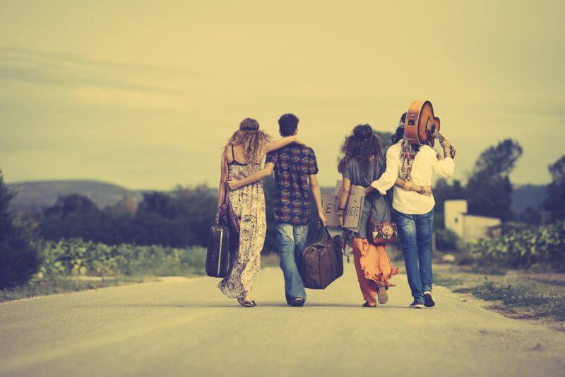 Group of hippie friends walk away. Vintage style