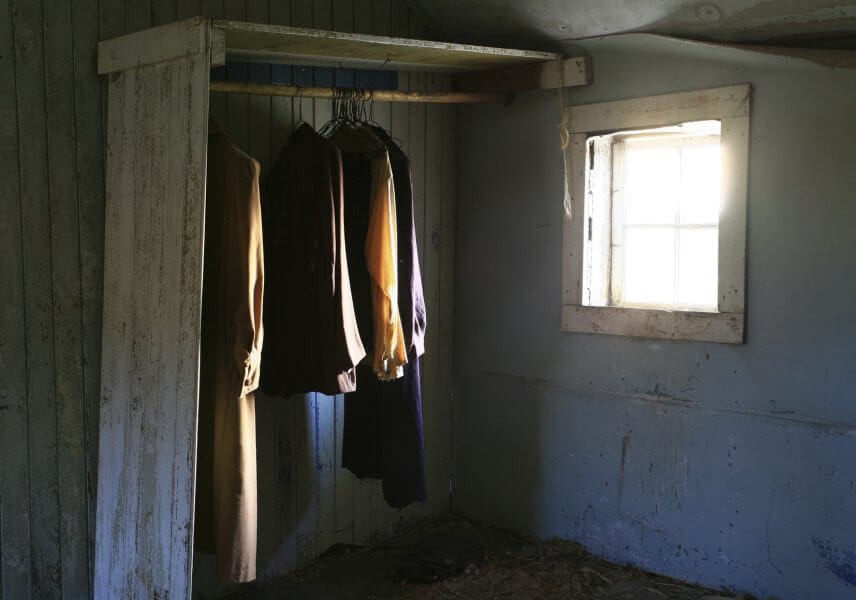 Clothes in an abandoned house.