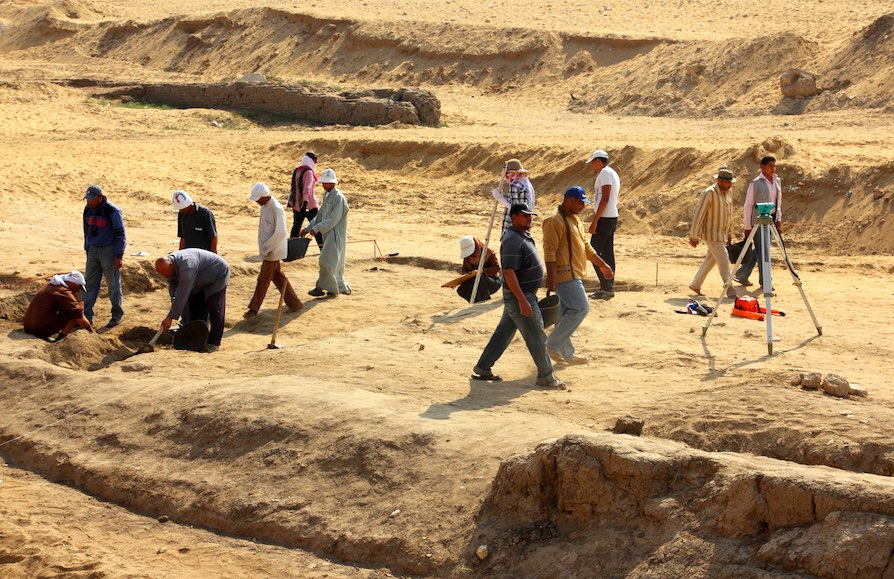 archaeological digging near statue of Sphinx in Egypt