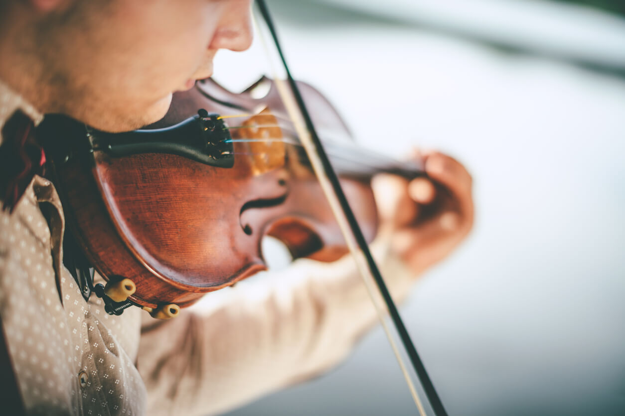 Close-up of teenage boy playing violin